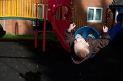 Balanceo del niño Foto de archivo libre de regalías