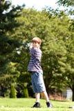 Balanceo sonriente del muchacho Fotografía de archivo libre de regalías