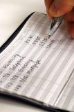 Balancieren des Scheckbuchs für das Scheckkonto Stockfotos