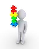 Balancierende Puzzlespielstücke der Person Lizenzfreie Stockbilder