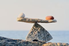 Balancing. Of pebbles on the top of boulder Royalty Free Stock Photography