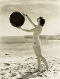 Balancing A Medicine Ball On The Beach Stock Photography