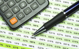 Balancing the Accounts. A calculator, pen, and financial statement royalty free stock image