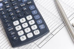 Balancing the Accounts. A financial statement with a calculator and a pen Stock Photos