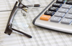 Balancing the Accounts. Calculator, glasses Stock Image