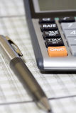 Balancing the Accounts. Calculator, pen Stock Photos