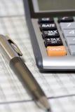 Balancing the Accounts. Calculator, pen Stock Photos