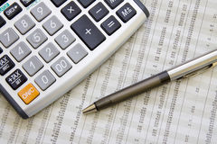 Balancing the Accounts. Calculator, pen Royalty Free Stock Image