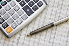 Balancing the Accounts. Calculator, pen Royalty Free Stock Image