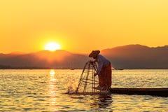 Myanmar travel attraction landmark - Traditional Burmese fisherman at Inle lake, Myanmar famous for their distinctive one legged stock image