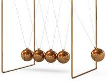 Balancing balls. Gold metal pendulum balls balancing from strings in Newton's cradle Stock Photos