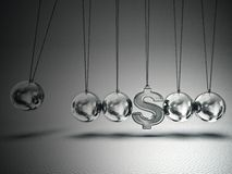 Balancing balls. Conceptual  balancing balls with dollar sign isolated on a grey Stock Photography