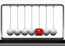 Balancing balls and red box Stock Photography
