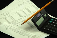 Balancing bank statement 3. Balancing business bank statement with pencil and calculator Royalty Free Stock Photo