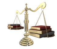 Balancing The Books. A gold justice scale with three books on either end balancing it out Royalty Free Stock Photography