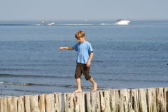 Balancing Boy. Boy balancing at the beach royalty free stock images