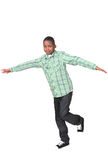 Balancing boy. Playing african boy balancing on one leg Stock Photography
