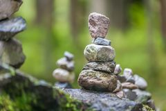 Balancing cairns in the forest royalty free stock images