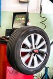 Balancing a car tyre Stock Photography