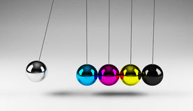 Balancing cmyk balls Royalty Free Stock Photo