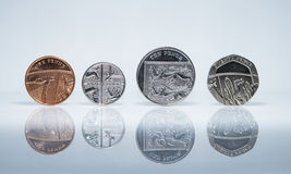 Balancing coins - Money Royalty Free Stock Images