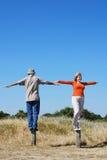 Balancing couple Stock Photo