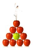 Balancing diet - woman balancing on red apples Royalty Free Stock Image