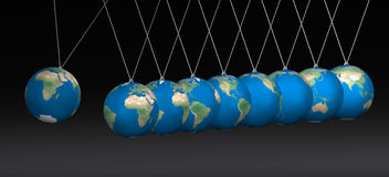 Balancing earth ball. Newton cradle balancing with earth balls over black Royalty Free Stock Images