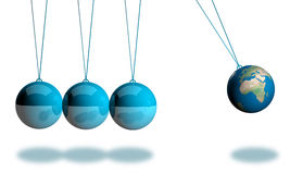 Balancing earth ball. Newton cradle balancing with earth balls over white Stock Photo