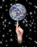 Balancing Earth on finger Royalty Free Stock Images