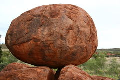Balancing egg-shaped boulder at Devil's Marbles. The Outback of Australia Royalty Free Stock Photos