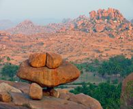 Balancing giant Boulders atop Malayavanta Hill in Hampi Stock Photo