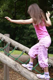 Balancing girl. Girl in pink balancing on the log Stock Photos