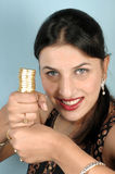 Balancing gold coins Royalty Free Stock Photography