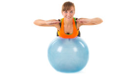 Balancing on Gymnastic ball Royalty Free Stock Photography