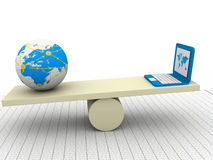 Balancing laptop and earth Stock Photography