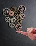 Balancing metal gears Stock Photo