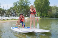 Balancing on the paddleboard. Recreation stock photos