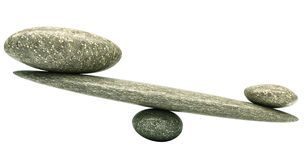 Balancing: Pebble stability scales with stones. Balancing: Pebble stability scales with large and small stones Royalty Free Stock Photography