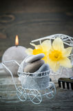 Balancing pebble stones and yellow flowers Stock Images