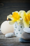 Balancing pebble stones and yellow flowers Stock Image