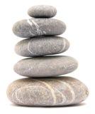 Balancing pebble tower. Isolated on white background Stock Photos