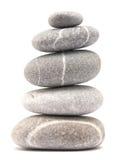 Balancing pebble tower. Balancing stone tower isolated on white background Stock Photos
