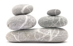 Balancing pebble tower. Balancing stone tower isolated on white background Stock Images