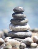 Balancing pebble tower. Balancing stones with beautiful bokeh Royalty Free Stock Image