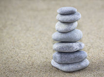 Balancing pebbles. Placed on sand Royalty Free Stock Photography