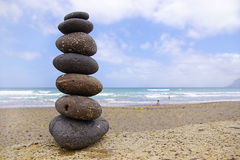 Balancing pebbles, summer, sun and ocean beach Royalty Free Stock Images