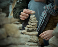 Balancing the pile of stone. Team work in balancing a pile of stones Stock Photos
