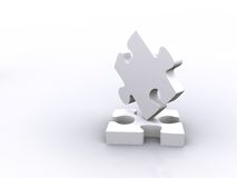 Balancing puzzle pieces Stock Photography