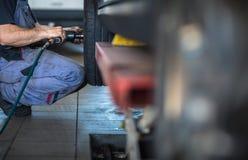 Balancing/repairing wheels on a modern ca royalty free stock image